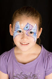Winged pony face painting design with the wings creating a mask. Perfect face paint design for a My Little Pony party.