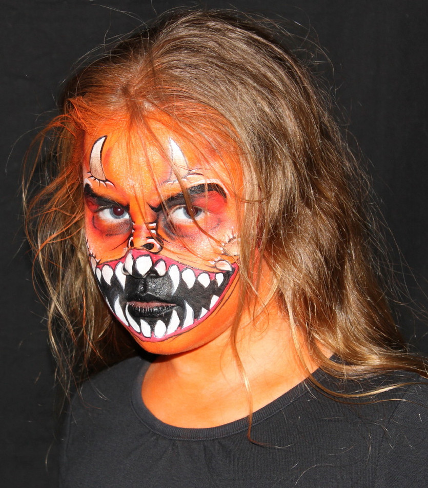 Orange monster face painting by Brisbane artist Beth Joyce.