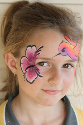 Hummingbird and hibiscus flower face painting