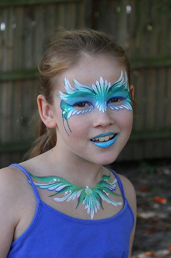 Painted masquerade mask in shades of blue painted by Brisbane face painter Beth Joyce