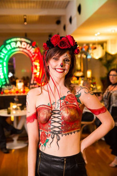 Day of the Dead inspired painted corset with matching headpiece.