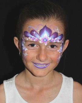 Fun colourful princess crown face painting design