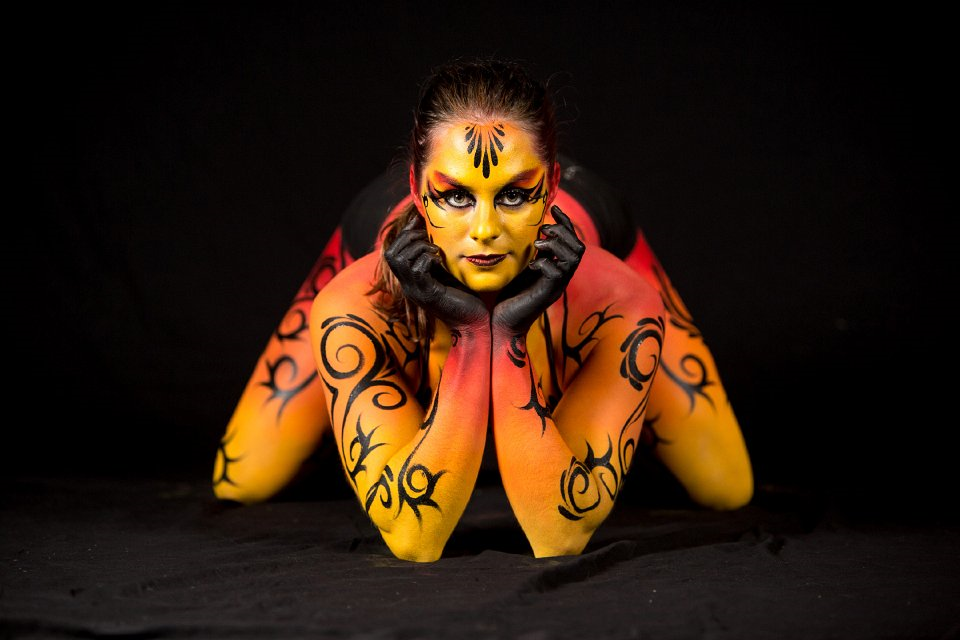 Cirque du Soleil body painting in shades of red, orange and yellow by Brisbane artist Beth Joyce.