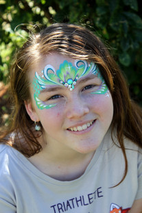 Masquerade mask painted in shades of teal and purple by brisbane face painter Beth Joyce