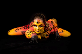 Shades of red and orange with black tribal detail Cirque du soleil inspired full body painting