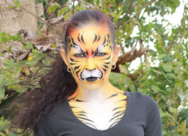 Angry tiger face painting design by Brisbane face painter Beth Joyce
