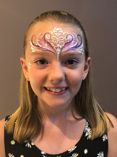 Delicate and swirly painted princess crown with splashes of pink and purple.