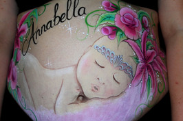 Belly painting of a beautiful baby girl wearing a princess crown surrounded by bright pink flowers painted by Brisbane prenatal art specialist Beth Joyce