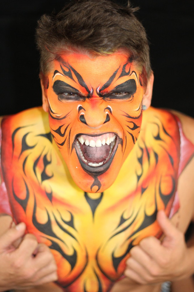 Flaming monster painted in shades of red, orange and yellow.