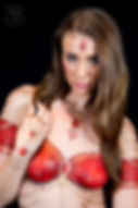 Red an gold sari body painting, painted jewellery and painted clothing