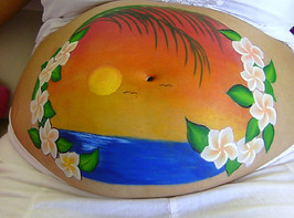 Tropical sunset belly painting featuring a sunset over the water with birds in the sky surrounded with frangipanni flowers and palm fronds