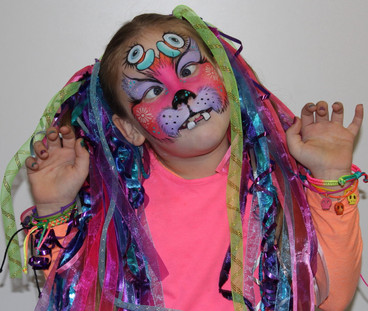This cute monster face painting by Beth Joyce shows that not all monsters have to be scary.