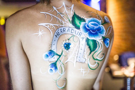 Stunning blue painted torso and Sugar Skull makeup design with beautiful blue one stroke roses
