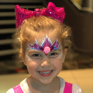 Sparkly pink and purple one stroke princess crown face paint design
