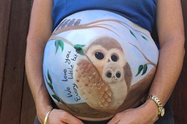 Beautiful belly painting of a Mother and baby owl sitting on a branch with the Father and siblings watching from above