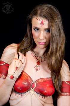 Body painted red sari inspired top with painted gold jewellery and detailing.