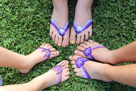 Fun purple and pink painted thongs and sandals by Brisbane face painter Beth Joyce