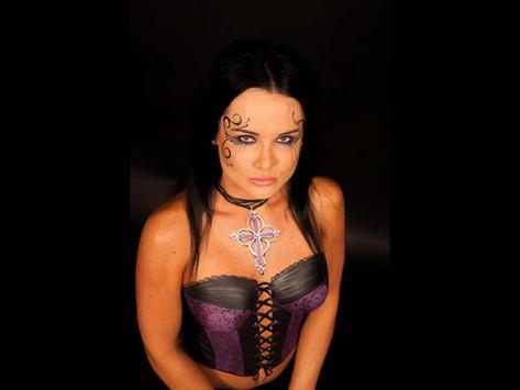 Painted purple and black corset by Brisbane body painter Beth Joyce.