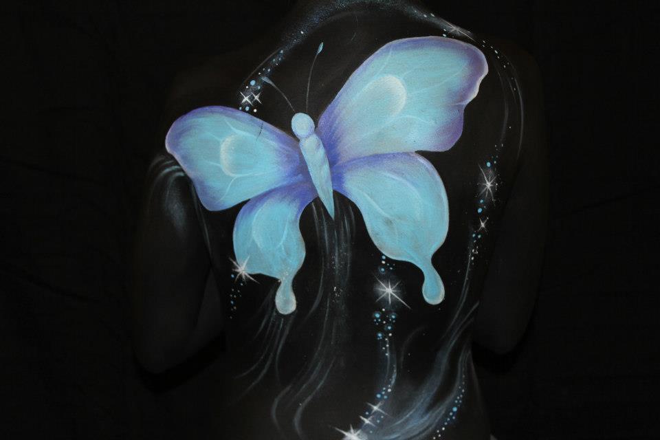 Blue butterfly painted on a models back by Brisbane artist Beth Joyce.
