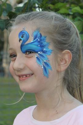 Pretty blue peacock inspired eye design by Brisbane face painter Beth Joyce