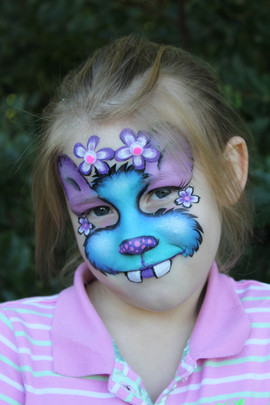 Cute purple and blue monster face painting by Brisbane Face Painter Beth Joyce