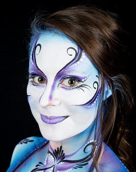 Blue and purple Cirque du Soleil inspired face painting