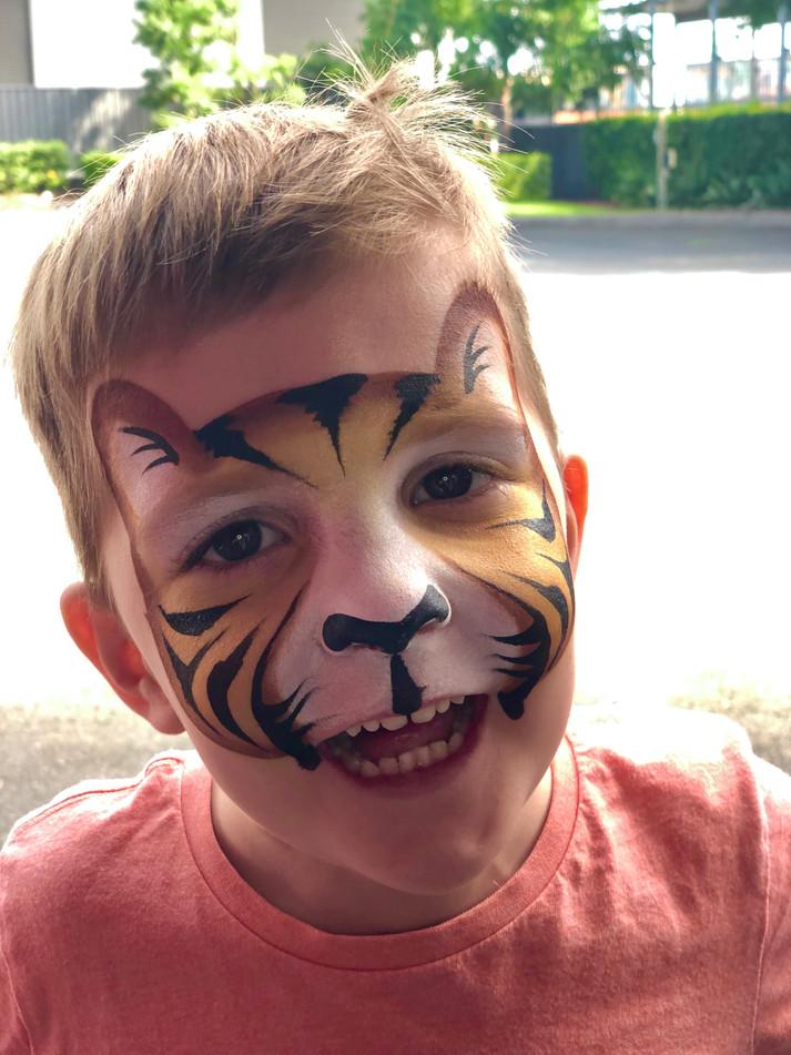 Cute tiger cub face painting by Brisbane artist Beth Joyce.