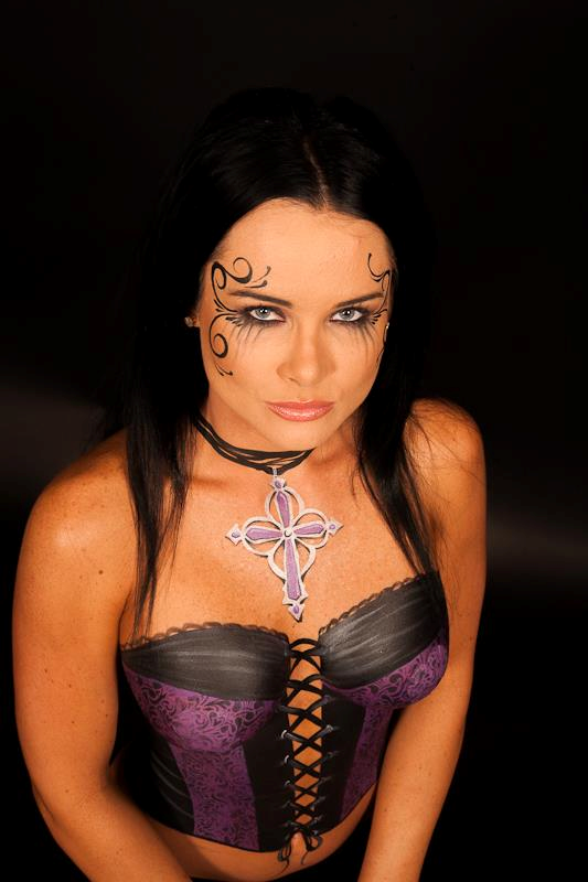 Painted purple and black corset with gothic style painted necklace.