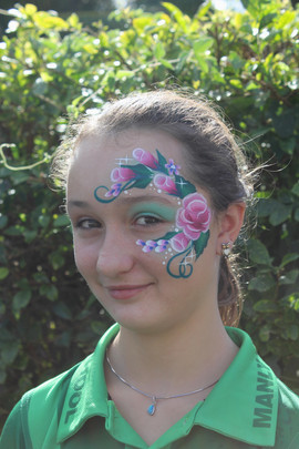 Pretty pink one stroke rose face painting design