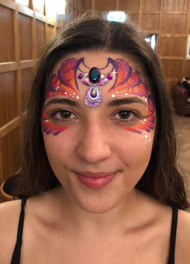 Tropical colours and a little bit of bling make this webby Halloween mask stunning rather than scary