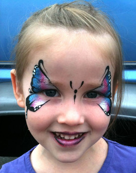Silver, pink and blue butterfly face painting design