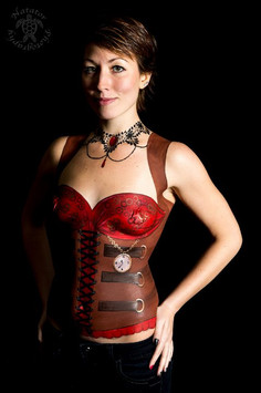 Body painted steam punk inspired corset with pocket watch detail.