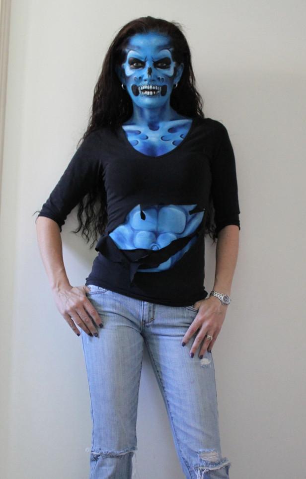 This blue alien monster was painted by Brisbane artist Beth Joyce on herself.