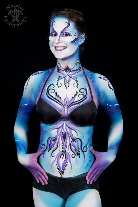 Swirly ethereal body paint design in shades of blue and purple by Brisbane body painter Beth Joyce.