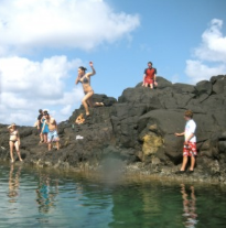 """Me jumping off a rock in Hawaii.  #Tag: Getting to Know the """"Person"""" Behind the Personal Finance Blog"""