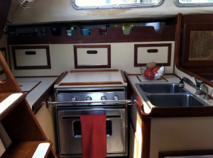 I Live in a 175 Square Foot Tiny Home - A Sailboat Kitchen Picture. Living on a sailboat can be a fun way to live. It is a true tiny home when living on a small sailboat, and you can travel the world at the same time! Are you interested in living on a small sailboat?
