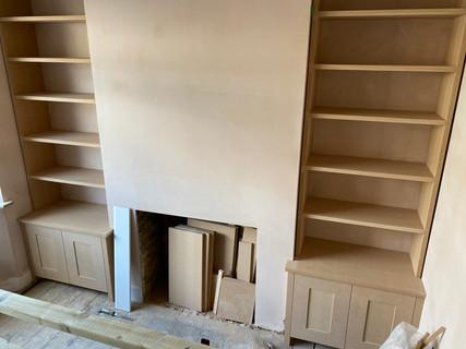 Bespoke bookshelf and cupboards