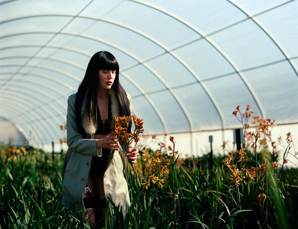 Goddess-Faustine-Cox-San-Francisco-Dominatrix-leather-fur-jacket-greenhouse-bdsm-fetish-botanical