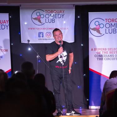 MC Noel Brodie smashing the 2019 June Torquay Comedy Club