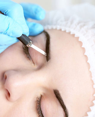 bigstock-Cosmetologist-applying-permane-