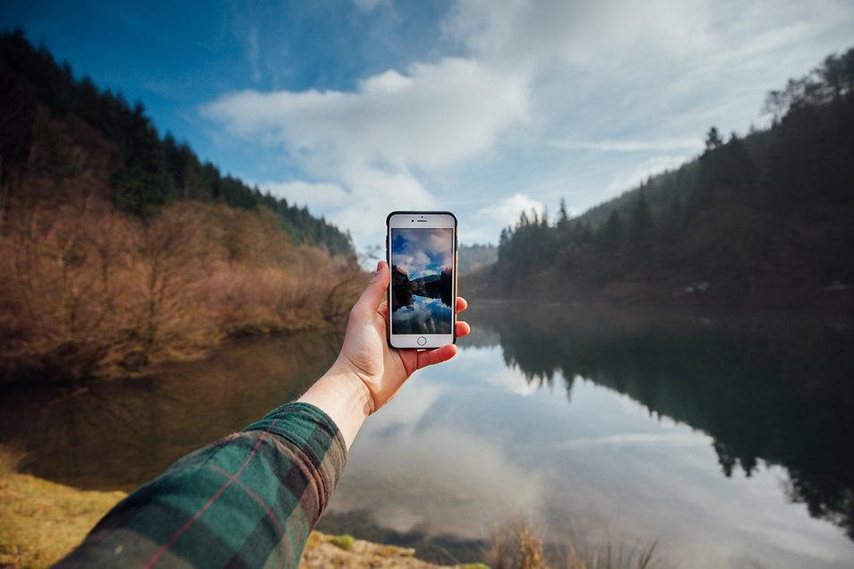 Phone Camera held by hand nature lake