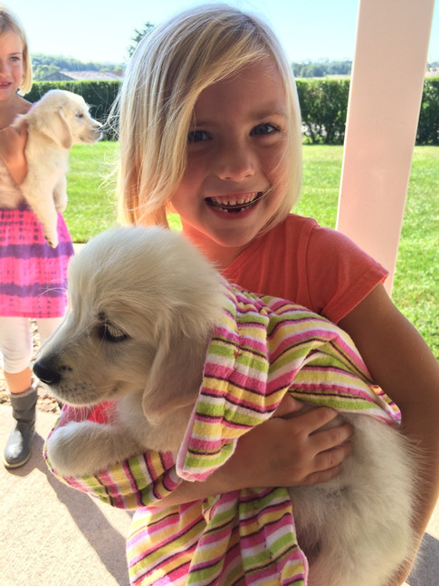 Kennedy is thrilled with her new pup!