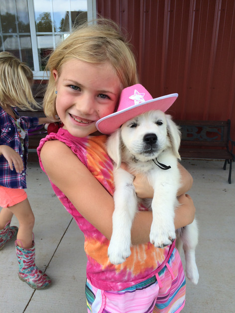Puppy Chloe in her cowgirl hat