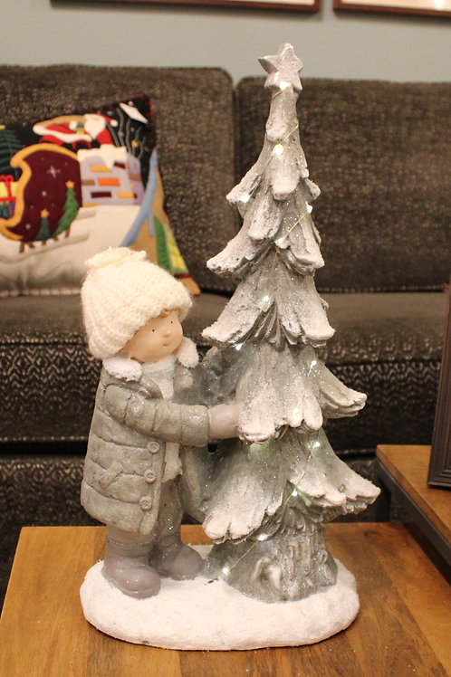 BOY WITH LIT TREE