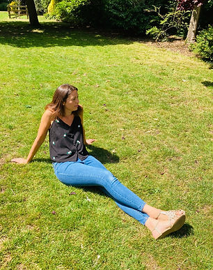 Victoria sitting down on grass
