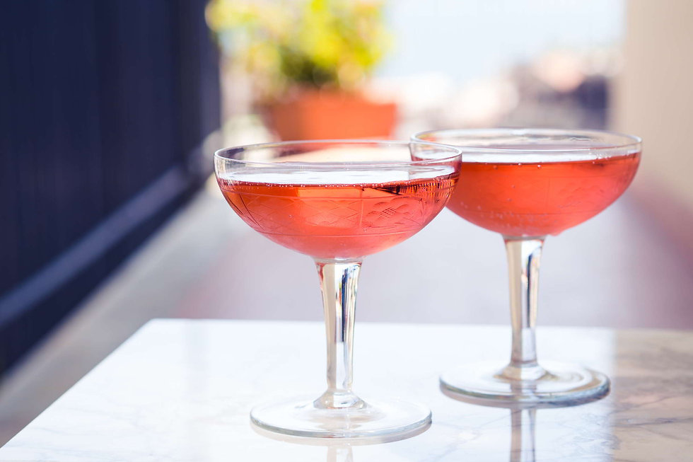 two-crystal-stemmed-glasses-with-rose-wi