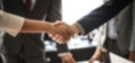 telecom handshake.jpg