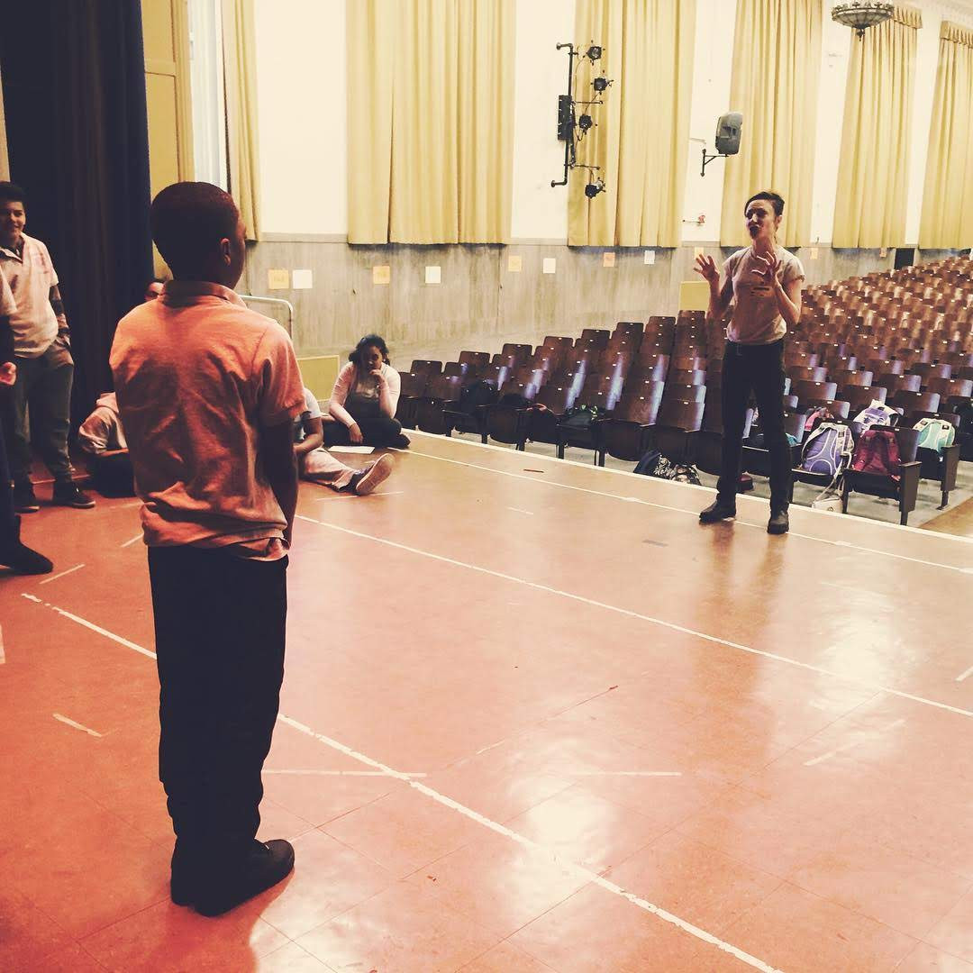 Rehearsal on the stage, teaching artist residency in NYC Title 1 public school