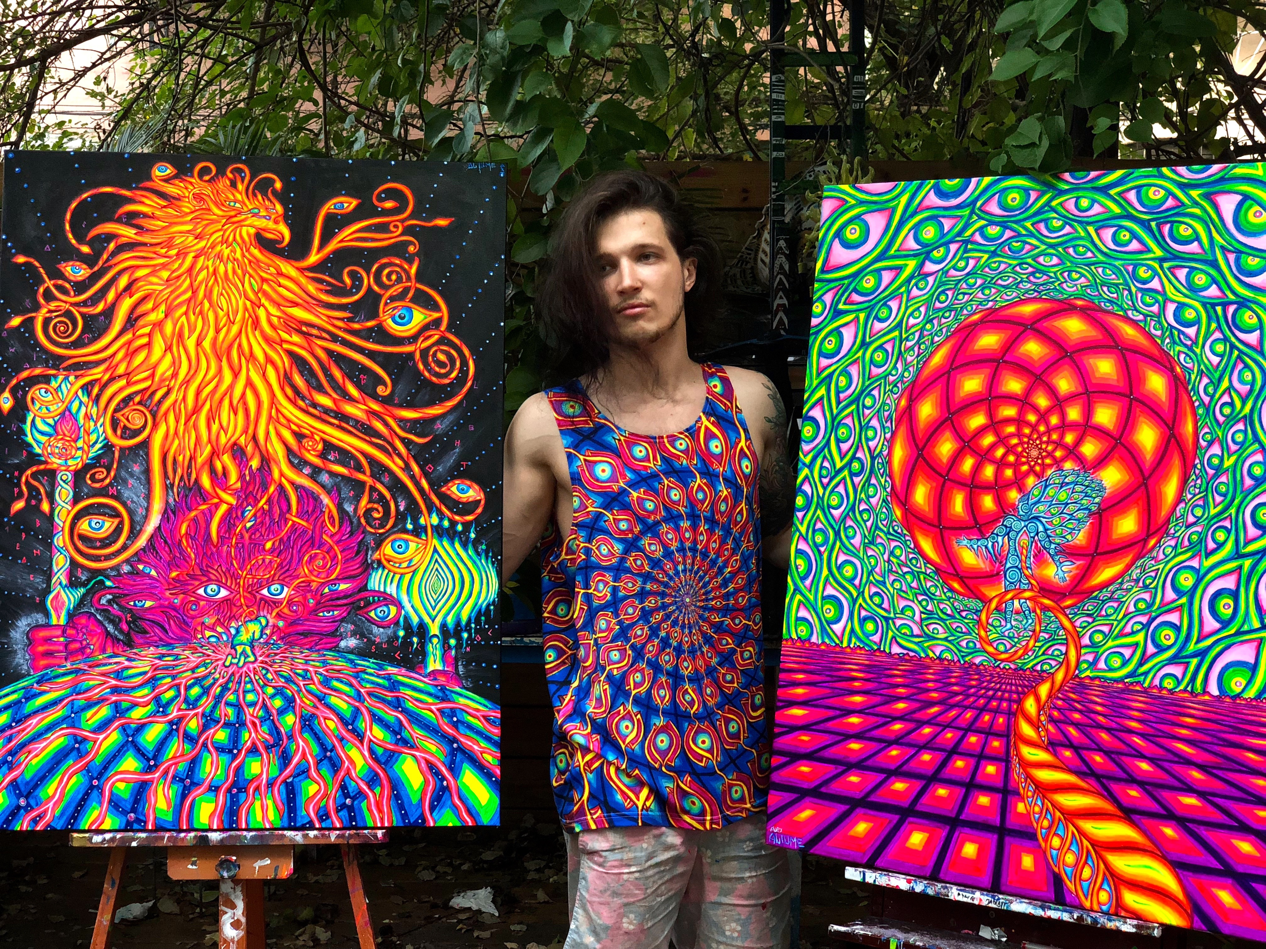 Alex Aliume With his paintings