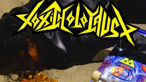 Toxic Holocaust Teams With Lurkville Skateboards For 'Primal Future: 2019' Skate Deck